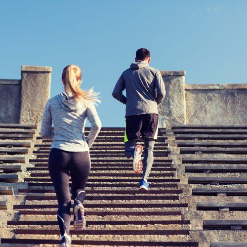couple running upstairs on stadium